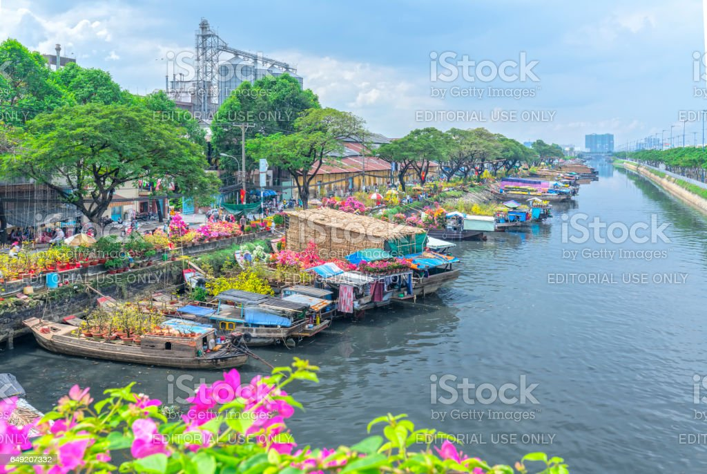 Flowers boats at flower market on along canal wharf stock photo