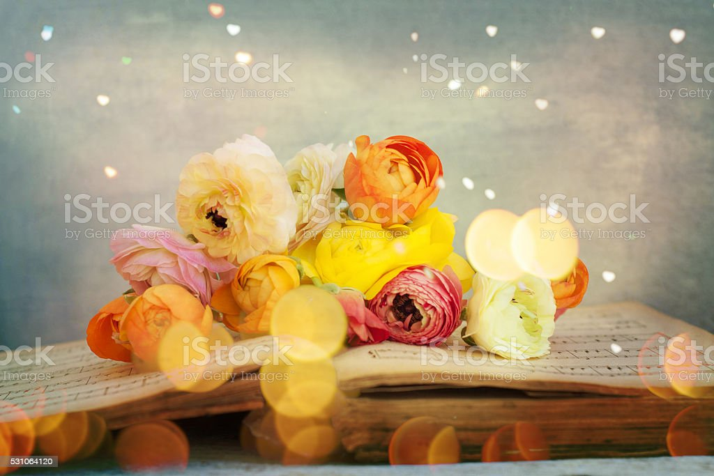 flowers Bouquet on the open book stock photo