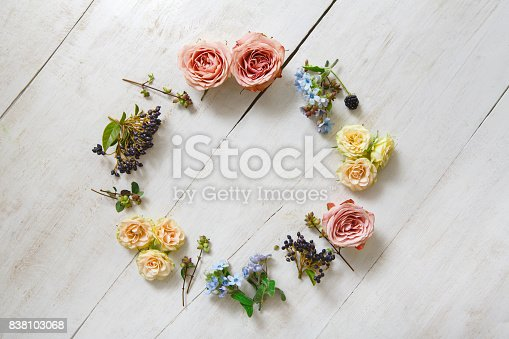 istock Flowers circle on white wood, top view 838103068