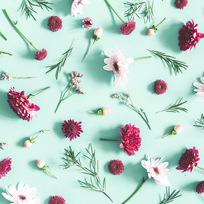 Flowers Composition Eucalyptus Leaves And Pink Flowers On Mint Background Flat Lay Top View Stock Photo - Download Image Now