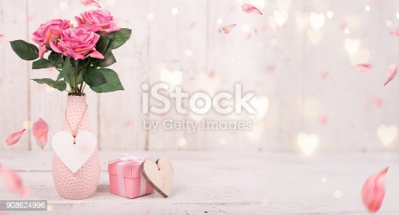 istock Flowers composition for Valentine's, Mother's or Women's Day. Pink flowers on old white wooden background 908624996