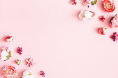 istock Flowers composition. Frame made of pink flowers on pastel pink background. Valentines day, mothers day, womens day concept. Flat lay, top view, copy space 1199450833