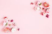 istock Flowers composition. Frame made of pink flowers on pastel pink background. Valentines day, mothers day, womens day concept. Flat lay, top view, copy space 1205515407