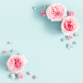istock Flowers composition. Frame made of rose flowers on pastel blue background. Valentines day, mothers day, womens day, spring concept. Flat lay, top view, copy space, square 1128622602