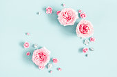 istock Flowers composition. Frame made of rose flowers on pastel blue background. Valentines day, mothers day, womens day, spring concept. Flat lay, top view, copy space 1130260060