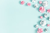 istock Flowers composition. Frame made of rose flowers on pastel blue background. Valentines day, mothers day, womens day, spring concept. Flat lay, top view, copy space 1130299061