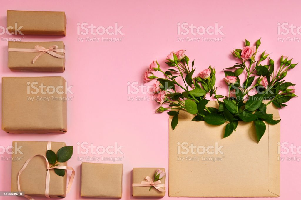 Flowers composition. Gifts and heart shaped rose flowers in envelope...