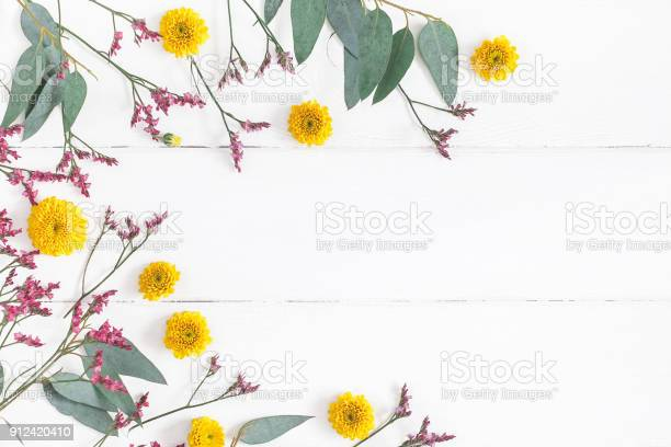 Flowers composition on white wooden background flat lay top view picture id912420410?b=1&k=6&m=912420410&s=612x612&h=avjdgkeqnpg2xrvzf3pfg vrobyjd1usfqyw3vdp0vu=