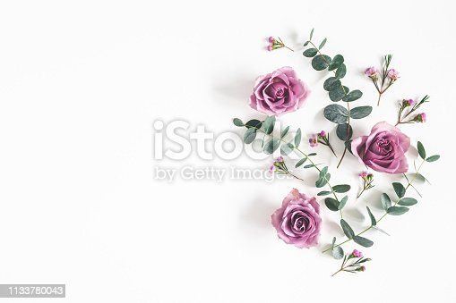 istock Flowers composition. Pattern made of eucalyptus branches and rose flowers on white background. Flat lay, top view, copy space 1133780043