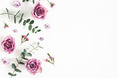 istock Flowers composition. Pattern made of eucalyptus branches and rose flowers on white background. Flat lay, top view, copy space 1137608399