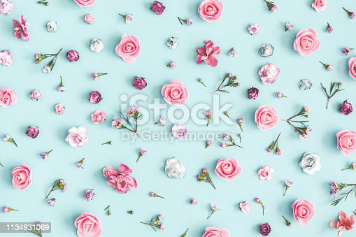 istock Flowers composition. Pattern made of pink flowers on pastel blue background. Flat lay, top view 1134931069