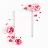 istock Flowers composition. Photo frame, rose flowers on white background. Valentines day, mothers day, womens day, spring concept. Flat lay, top view, copy space, square 1133191420