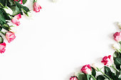 istock Flowers composition. Pink and white rose flowers on white background. Valentines day, mothers day, womens day concept. Flat lay, top view, copy space 1127472426