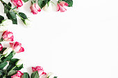 istock Flowers composition. Pink and white rose flowers on white background. Valentines day, mothers day, womens day concept. Flat lay, top view, copy space 1127773312