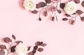istock Flowers composition. Pink flowers and eucalyptus leaves on pastel pink background. Flat lay, top view, copy space 1138996206