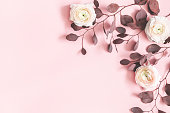 istock Flowers composition. Pink flowers and eucalyptus leaves on pastel pink background. Flat lay, top view, copy space 1139504901