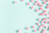 istock Flowers composition. Pink rose flowers on pastel blue background. Valentines day, mothers day, womens day concept. Flat lay, top view, copy space 1098217878