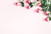 istock Flowers composition. Pink rose flowers on pastel pink background. Valentines day, mothers day, womens day concept. Flat lay, top view, copy space 1130755729