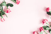 istock Flowers composition. Pink rose flowers on pastel pink background. Valentines day, mothers day, womens day concept. Flat lay, top view, copy space 1133190274