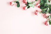 istock Flowers composition. Pink rose flowers on pastel pink background. Flat lay, top view, copy space 1134930356