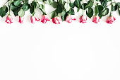 istock Flowers composition. Pink rose flowers on white background. Valentines day, mothers day, womens day concept. Flat lay, top view, copy space 1127472502