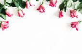 istock Flowers composition. Pink rose flowers on white background. Valentines day, mothers day, womens day concept. Flat lay, top view, copy space 1127558671