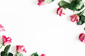 istock Flowers composition. Pink rose flowers on white background. Valentines day, mothers day, womens day concept. Flat lay, top view, copy space 1127558881