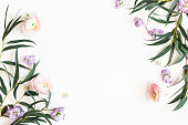 istock Flowers composition. Purple flowers and eucalyptus leaves on white background. Flat lay, top view, copy space 1138994679