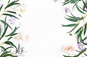 istock Flowers composition. Purple flowers and eucalyptus leaves on white background. Flat lay, top view, copy space 1142359176