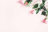 istock Flowers composition. Rose and gypsophila flowers on pastel pink background. Valentines day, mothers day, womens day concept. Flat lay, top view, copy space 1127474871