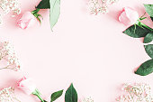 istock Flowers composition. Rose and gypsophila flowers on pastel pink background. Valentines day, mothers day, womens day concept. Flat lay, top view, copy space 1128621560