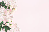 istock Flowers composition. Rose and gypsophila flowers on pastel pink background. Valentines day, mothers day, womens day concept. Flat lay, top view, copy space 1133190132