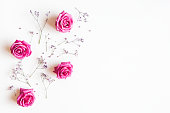 istock Flowers composition. Rose and gypsophila flowers on white background. Spring concept. Flat lay, top view, copy space 1221383872