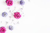 istock Flowers composition. Rose and gypsophila flowers on white background. Spring concept. Flat lay, top view, copy space 1224119625