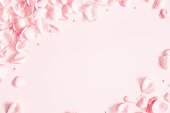 istock Flowers composition. Rose flower petals on pastel pink background. Valentines day, mothers day, womens day concept. Flat lay, top view, copy space 1098216834
