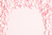 istock Flowers composition. Rose flower petals on pastel pink background. Valentines day, mothers day, womens day, wedding concept. Flat lay, top view, copy space 1127559900