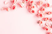 istock Flowers composition. Rose flowers on pink background. Valentines day, mothers day, womens day concept. Flat lay, top view, copy space 1205515671