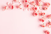 istock Flowers composition. Rose flowers on pink background. Valentines day, mothers day, womens day concept. Flat lay, top view, copy space 1207288354
