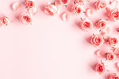 istock Flowers composition. Rose flowers on pink background. Valentines day, mothers day, womens day concept. Flat lay, top view, copy space 1211787242