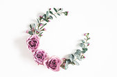istock Flowers composition. Wreath made of eucalyptus branches and rose flowers on white background. Flat lay, top view, copy space 1133780051