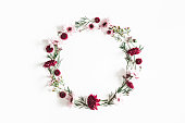 istock Flowers composition. Wreath made of eucalyptus leaves and pink flowers on white background. Flat lay, top view, copy space 1125610216
