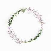 istock Flowers composition. Wreath made of gypsophila flowers, eucalyptus leaves on white background. Spring concept. Flat lay, top view, copy space 1221383902