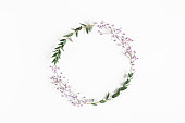 istock Flowers composition. Wreath made of gypsophila flowers, eucalyptus leaves on white background. Spring concept. Flat lay, top view, copy space 1251514503
