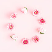 istock Flowers composition. Wreath made of pink flowers on pink background. Flat lay, top view, copy space 1243077892