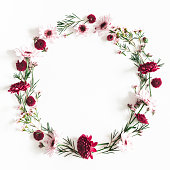 istock Flowers composition. Wreath made of red flowers on white background. Flat lay, top view, copy space, square 1128621678
