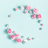 istock Flowers composition. Wreath made of rose flowers on pastel blue background. Valentines day, mothers day, womens day, spring concept. Flat lay, top view, copy space, square 1127775690