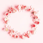 istock Flowers composition. Wreath made of rose flowers on pink background. Valentines day, mothers day, womens day concept. Flat lay, top view, copy space 1211787241