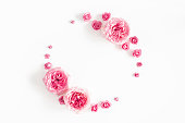 istock Flowers composition. Wreath made of rose flowers on white background. Valentines day, mothers day, womens day, spring concept. Flat lay, top view, copy space 1128622619
