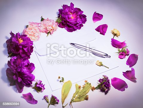 968272356istockphoto Flowers, envelope and pen on a lilac 538663594