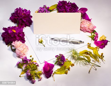 968272356istockphoto Flowers, envelope and pen on a lilac 538794954
